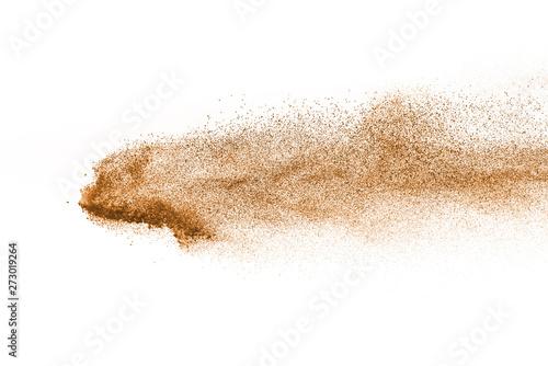 Obraz na plátně  Explosion of brown powder on white background.