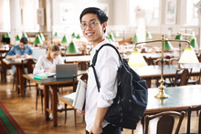 Smiling Asian Teenager Student...