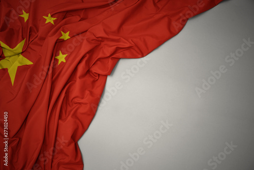 Fototapeta waving national flag of china on a gray background.