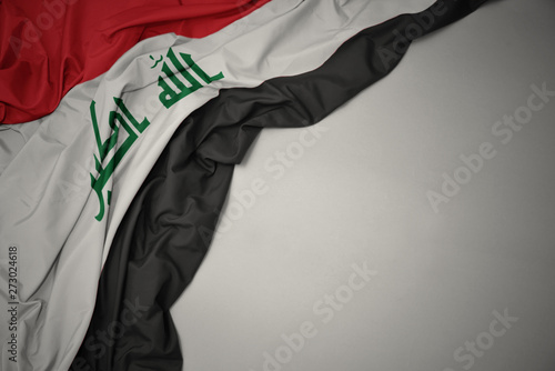 waving national flag of iraq on a gray background. Tablou Canvas