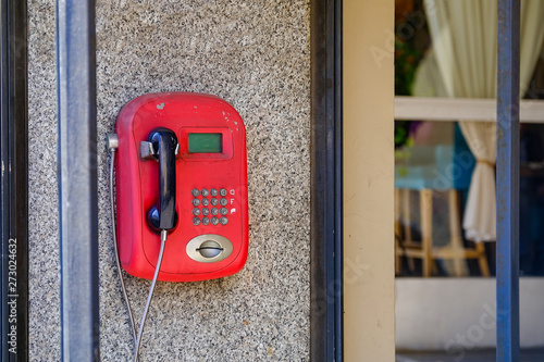 Old red pay phone  Payment was made by cards  Now the rarity