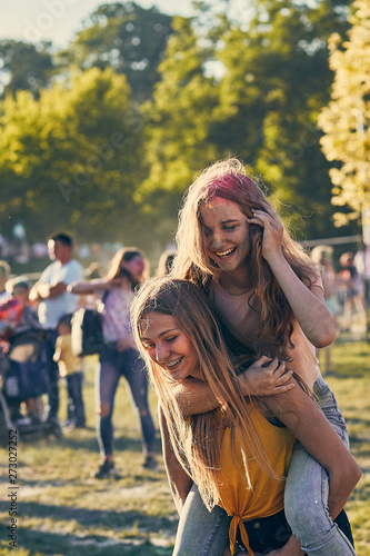 Portrait of happy young girls on holi color festival Canvas Print