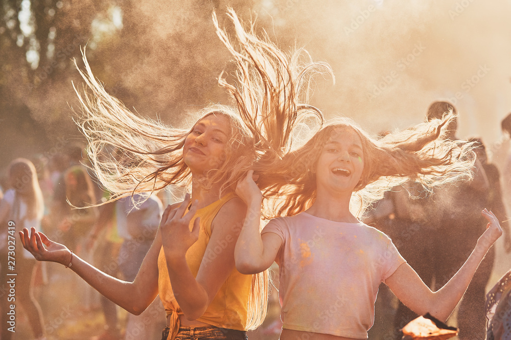 Fototapety, obrazy: Portrait of happy young girls on holi color festival
