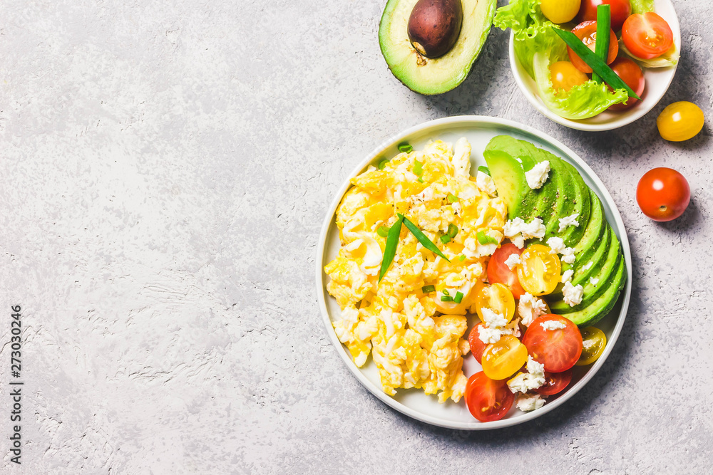 Fototapety, obrazy: Scrambled eggs with cherry tomatoes , avocado feta cheese and olive oil. Top view, space for text.