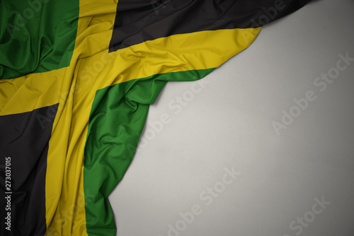 waving national flag of jamaica on a gray background. Wallpaper Mural