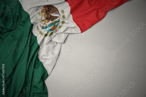 Photo sur Aluminium Amérique du Sud waving national flag of mexico on a gray background.