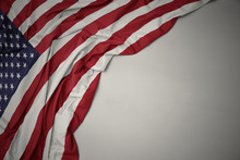 Waving National Flag Of United States Of America On A Gray Background.