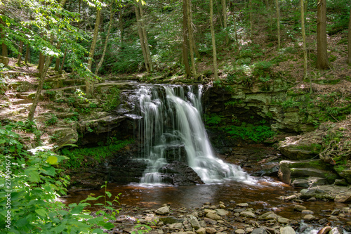 A waterfall in the middle of the forest peacefully flowing