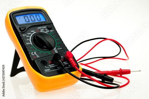 Digital multimeter with probes and blue backlit display on a white background Canvas Print