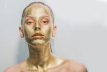Gold Make-up Face Mask, Closeup Healthy Young Woman Gold