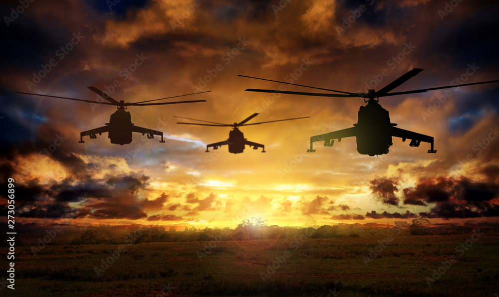 Fototapeta Helicopter silhouettes on sunset background