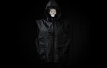 Black Hood With Skull On A Dark Background
