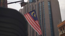 Malaysian Flag In Kuala Lumpur Street (dolly & Tilt Movement) Modern Building In The Background