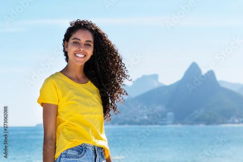 Fotografie, Obraz  Schöne Brasilianerin am Strand in Rio de Janeiro