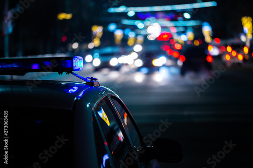 Canvastavla police car lights at night in city with selective focus and boke blur