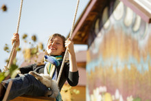 Smiling Young Woman On Rope Sw...