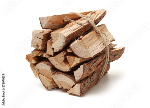 Foto Pile of firewood isolated on a white background