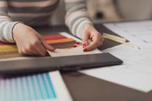 Professional Decorator Choosing Fabric Swatches
