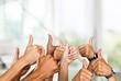 Leinwandbild Motiv Group of people hands showing thumbs up signs on background