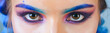 Beautiful macro shot of female eye with colorful makeup. Perfect shape of eyebrows, rainbow eyeshadows and long eyelashes. Cosmetics and make-up. Closeup macro shot of fashion liner eyes visage.