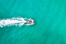 Beautiful Aerial View Jet Ski In Sea. Entertainment On Water Bikes In Sea Turquoise Water. Tourists Have Fun On Vacation. Aerial View. Top View. People Are Playing A Jet Ski. Amazing Nature Background