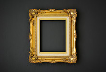 Gold Vintage Picture Frame On Black Color Wall Background, Copy Space, Funeral And Mourning Concept