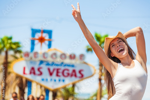 Photo  Las Vegas sign USA vacation fun american tourist cowgirl woman on road trip travel screaming of joy with cowboy hat on The Strip