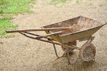 Two Wheeled Earth Moving Cart And Tools For Gardening After Work In The Farm.
