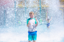 Young Boy Getting Soaking Wet ...