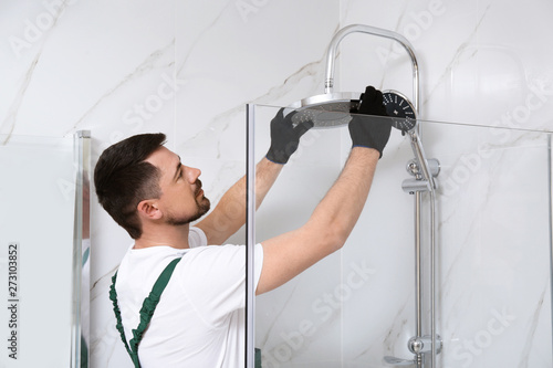 Obraz Professional handyman working in shower booth indoors - fototapety do salonu