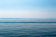 Lake Baikal on a sunny day. Clear blue sky and water. Free space for text. Background for design, screen saver