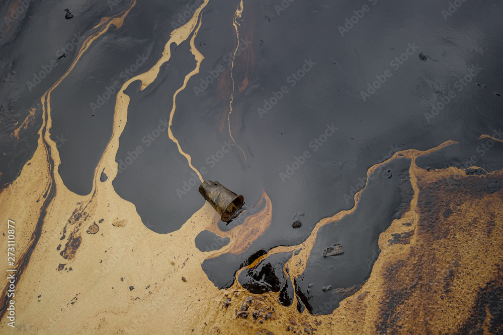 Fototapety, obrazy: Oil sludge contaminating the sea during the oil spill disaster in Samet Island, Rayong, Thailand.