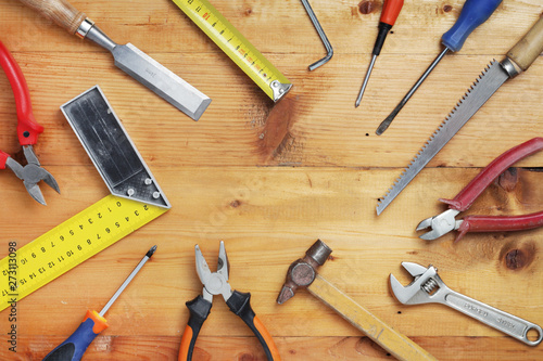 Fotografia  Working tools on wooden rustic background with copy space