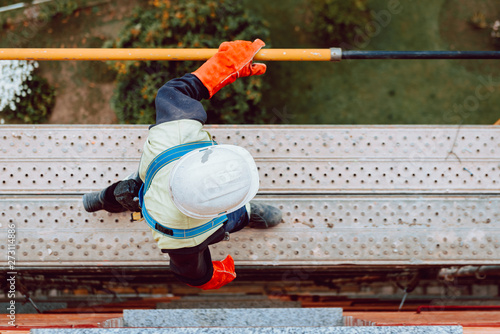 workers work removing a scaffolding at high altitude in Oviedo, Asturias, Spain Fototapeta