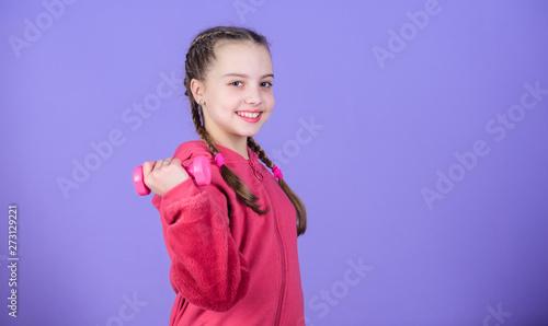 Child hold little dumbbell violet background  Sport for teens  Easy