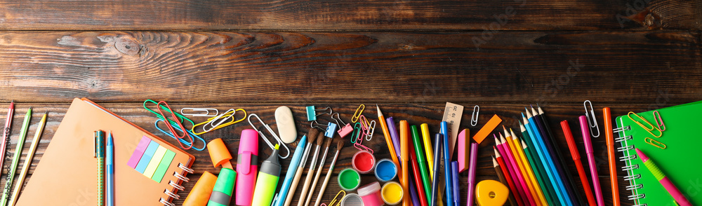 Fototapety, obrazy: Flat lay composition with school supplies on wooden background, space for text