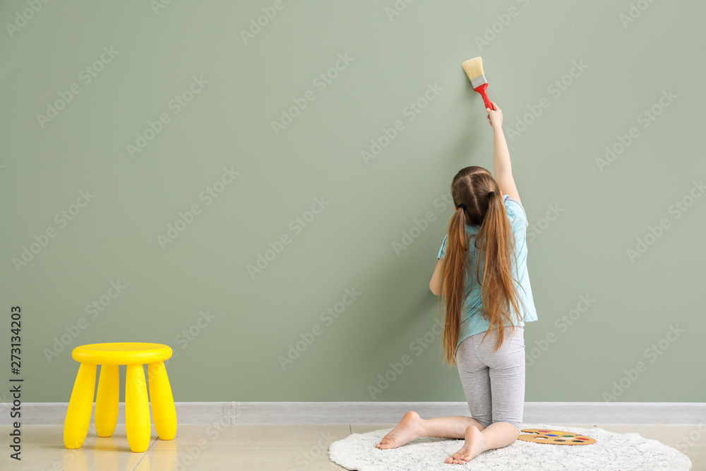 Fototapety, obrazy: Cute little girl painting on wall in room