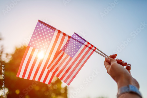 Fotografia  Woman holding USA flag. Celebrating Independence Day of America