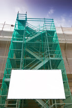 Metal Scaffolding, With Prefabricated Components And Blank Billboard, To Work On The Facade For The Renovation Of The Plaster Wall