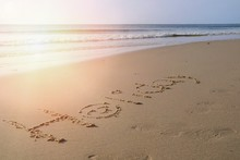 """Text """"Holiday"""" With The Waves Beat At The Beach And  Sunlight In The Summer Morning. Nature And Travel Concept."""