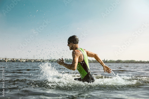 Professional triathlete swimming in river's open water Canvas Print