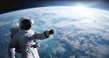 Astronaut Conducting Spacewalk On Earth Orbit.