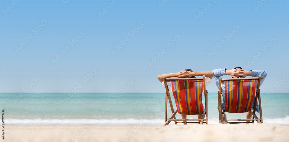 Fototapety, obrazy: Couple relaxing on chair beach over sea background.