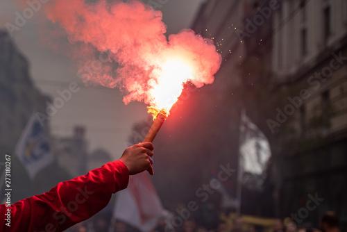 Fototapeta Man holding flaming torch during protest obraz
