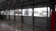 In the painting chamber of the automobile plant the car body moves.