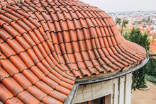 Exterior Of Brick House With Red Roof Tiles, Prague. Retro Red Tile Roof Of Old House