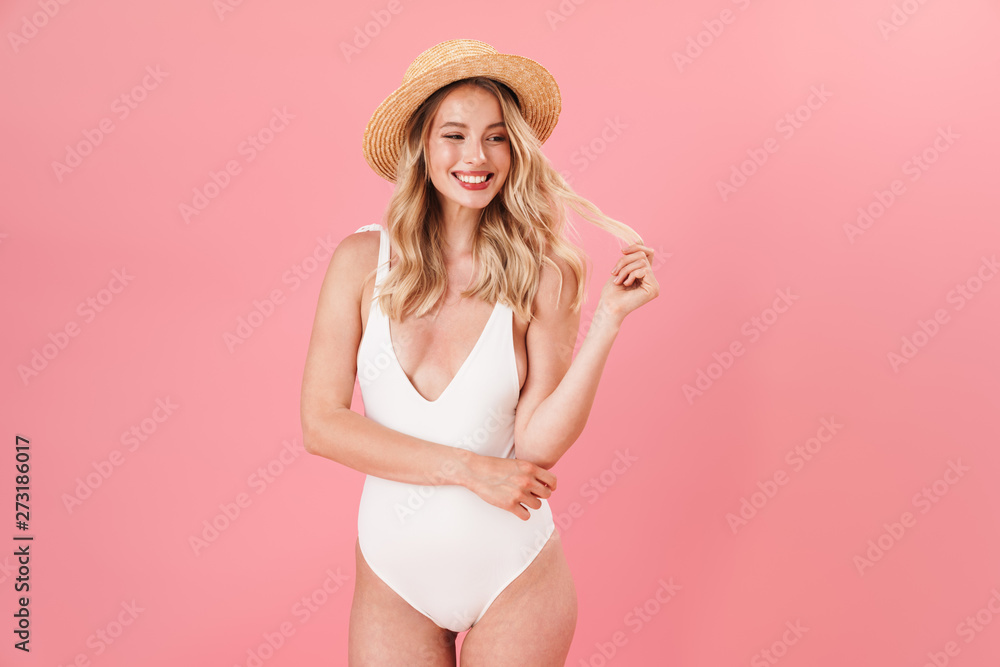 Fototapety, obrazy: Happy young woman posing isolated over pink wall background dressed in swimwear.