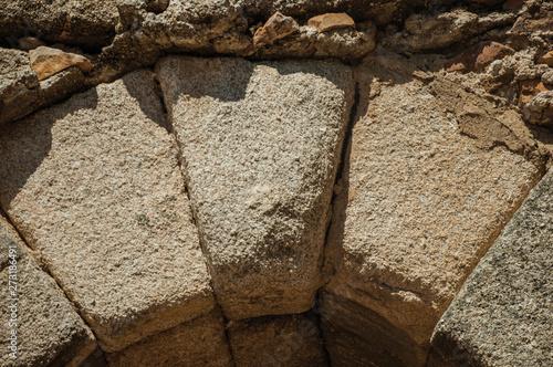 Valokuvatapetti Keystone at the apex of a masonry arch at Merida