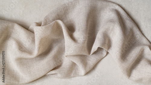Foto Flap of fine linen or hamp fabric on a gray background