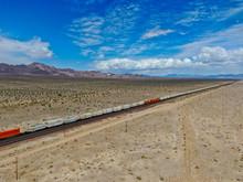 Cargo Locomotive Railroad Engine Crossing Arizona Desert Wilderness. Freight Train Passing By The Desert. USA